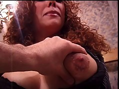 Big tits redhead enjoys her tits being worked upon by her master