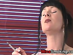 Smoking a cigarette in lingerie