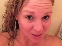 MILF getting a facial in the shower