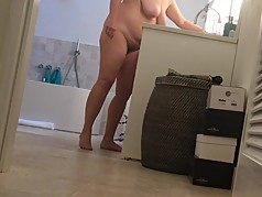 holiday MILF caught on bathroom hidden cam