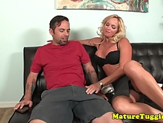 Seductive milf jerking dick on couch
