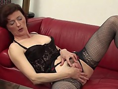 Naughty housewife playing with her moist pussy