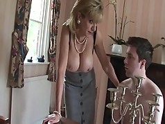 British MILF Teases Young Lad With Her Tits